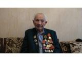 Нотариусы поздравили коллегу - ветерана ВОВ с Днём Победы